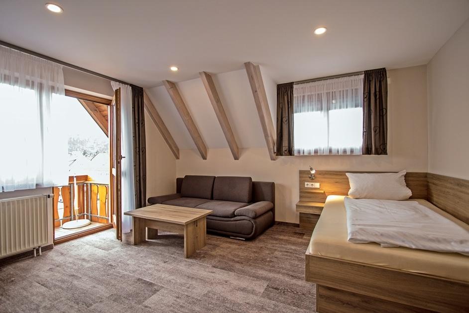 Ferienwohnung Klosterblick Wohnzimmer mit 3. Bett