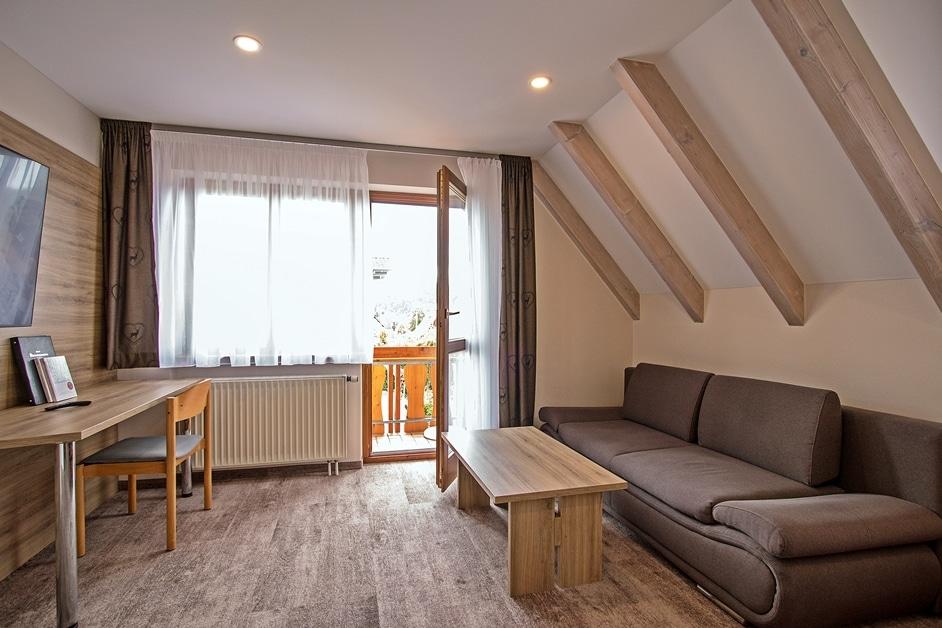 Ferienwohnung Klosterblick Wohnzimmer mit großem Flachbild-TV